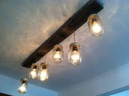 mason jar and reclaimed wood track lighting by lengaresdesign to hang over the kitchen island betty 8 light mason jar
