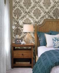 room elegant wallpaper bedroom: elegant bedroom decor idea with a damask wallpaper feature wall behind the bed