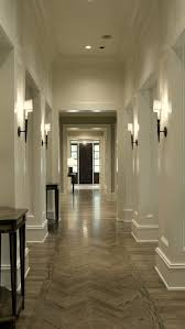 gallery traditional hallway idea in atlanta with white walls and dark hardwood floors basement lighting options