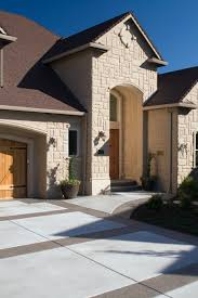 A Gorgeous Stone Home Exterior With A Wood Garage Door And Stained - Exterior garage door