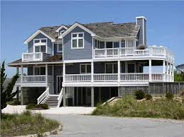 Casual  Informal and Relaxed Define Coastal House PlansTwo house plans illustrate the pier and pile foundations  On the left is a four bedroom design  two master suites     baths  covered porch  and two story