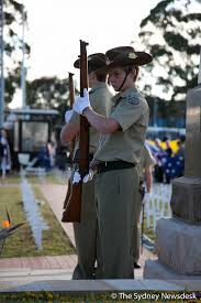 photo essay anzac day dawn service at brookvale the sydney newsdesk honor guards stand next to the cenotaph for anzac day in brookvale sydney