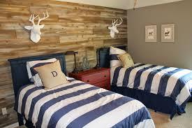 impressive white dear head ornaments above blue twin bed for boys beside solid oak dresser blue themed boy kids bedroom