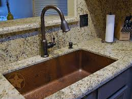 hammered copper kitchen sink: oil rubbed bronze is the color of choice to pair with hammered copper kitchen sinks as