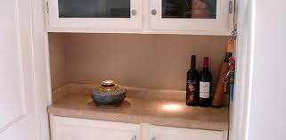 under cabinet led light shining on kitchen counter cabinet lighting puck light