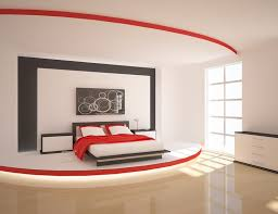 red wall paint black bed: a stage like platform adds modern luxury to this red and black bedroom the layered paint treatment on the headboard wall and accents of red and black