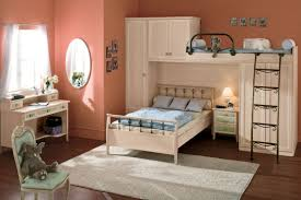 classic cream pine wood loft bunk bed built in wardrobe having black polished iron ladder placed built in study furniture