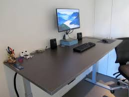 its very large super stable and being able to switch between sitting and standing is better for your health and makes you feel more energetic bekant desk sit stand screen