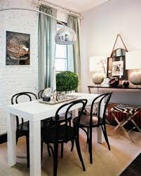 work space lonny mag an arc floor lamp above a white conference table with black black bentwood chairs