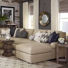room simple lined beige sofa  high end look when all of the components of a complete design are the