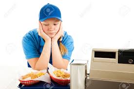 unhappy teenage girl has a boring job serving fast food isolated stock photo unhappy teenage girl has a boring job serving fast food isolated on white