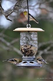 mason jar feeders 23 diy birdfeeders that will fill your garden with birds build diy mason