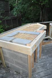 diy tile kitchen countertops: wonderful outdoor kitchen cinder block frame with granite tile for outdoor kitchen countertop and combine with
