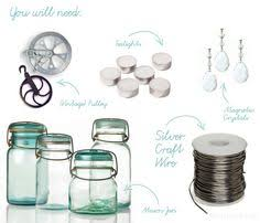 mason jar chandelier on a bike rim or pulley as shown alternating length wagon wheel mason jar