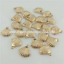 20347 35pcs kc light gold alloy ocean beach theme round sea shell conch pendant beach theme lighting