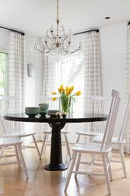 black and white dining table set: round black dining table with white dining chairs view full size