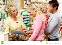female s assistant in clothing store stock photography image female s assistant in health food store stock photo