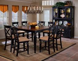 dark brown wooden dining table framed black dining table with brown chusion chairs classic candle place frui