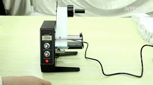 <b>automatic label dispenser</b> - YouTube