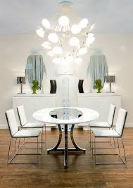 view in gallery modern art deco dining room with round table and white chairs art deco furniture san francisco