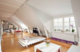 attic penthouse has white charm reminds of fairy tales attic lighting ideas