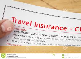 travel insurance claim application form and human hand on brown travel insurance claim application form and human hand on brown