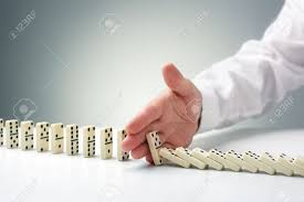 domino effect stock photos images royalty domino effect domino effect stopping the domino effect concept for business solution strategy and successful intervention