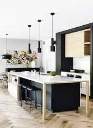 modern kitchen with a large island and black pendant lights black modern kitchen pendant lights