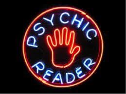 "neon sign reading ""psychic reader"""