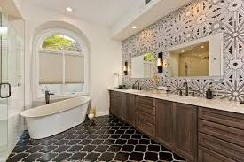 arts crafts bathroom vanity: stylish white master bathroom featuring ann sacks lux tile