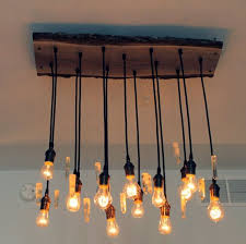 live edge reclaimed wood mantel live edge black walnut wood chandelier with antique bulbs and amazing wooden chandelier