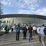 What it's like Riding Apple's Spinning Glass Elevator in Steve Jobs Theater