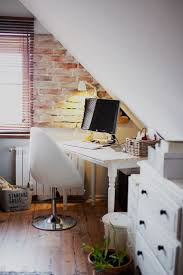home office nook in an attic with partial brick wall attic office ideas