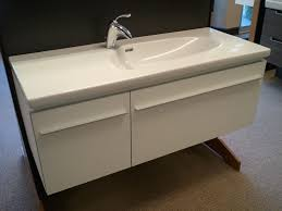 bathroom vanity unit units sink cabinets: bathroom floating white wooden bathroom vanity with rectangle white acrylic sink on dark brown bathroom