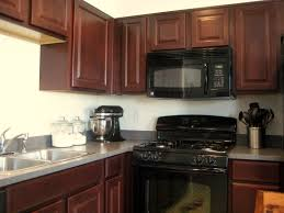 Colored Kitchen Appliances I Like This Look A Lot Black Appliances Cherry Cabinets And