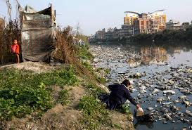 photo essay lives of illegal squatters on the banks of river copyright story south asia laxmi lama collects water from the polluted bagmati river to wash her sibling lama usually