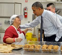 lanham md at costco obama touts his plan to boost wages us president barack obama r greets a costco bakery employee as he tours the