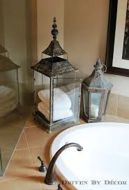 image bathtub decor: a large lantern as a unique spot to store towels by the bathtub