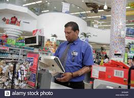 walgreens stock photos walgreens stock images page alamy miami beach florida walgreens pharmacy drug store shopping hispanic man cashier store manager stock image