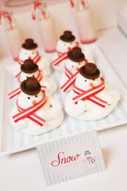 household dining table set christmas snowman knife: christmas dessert table for romantic homes magazine by a little polkadot snowmen meringues with sour straps as scarf and chocolate fondant for hat