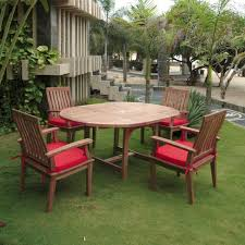 extension table f: anderson teak  person teak patio dining set with extension table shown with jockey red