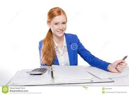 young businessw is calculating and writing on a paper royalty young businessw is calculating and writing on a paper