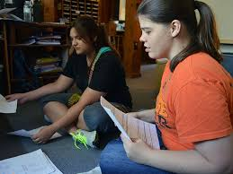 Help In Crisis helps domestic  sexual assault victims Cherokee Nation citizen Gina Baber      right  and Kaylee Lawrence      help sort through papers at the Help In Crisis office in Tahlequah  Oklahoma