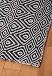 Black and white diamond pattern rug