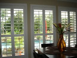 measuring plantation shutters sliding traditional dining room design with plantation blinds and dark wood di