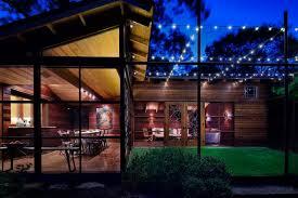 make outdoor magic with string lighting backyard string lighting ideas
