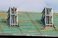 roof repair place: house roof and two chimney repair work place stock photo