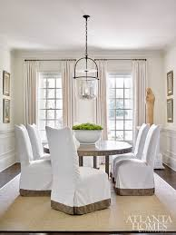 dining table parson chairs interior: custom slipcovered chairs and an expanding dining table from bungalow classic lend themselves to gatherings during