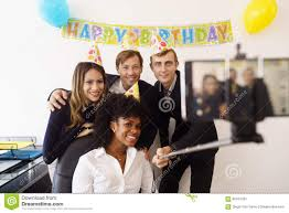 business colleagues at office party stock photo image  business people taking selfie phone at office party royalty stock photography