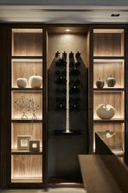 concealed lighting display shelving with wine storage aura lifestyle mountain and rocks bookcase lighting ideas